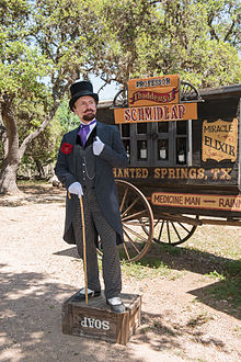 220px-Snake-oil_salesman_Professor_Thaddeus_Schmidlap_at_Enchanted_Springs_Ranch,_Boerne,_Texas,_USA_28650a